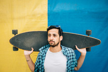 Bearded Man Holding Skateboard