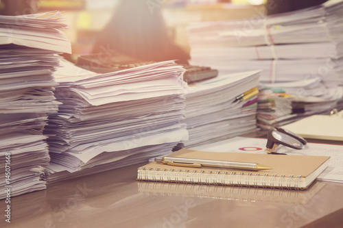 Fototapeta Business Concept, Pile of unfinished documents on office desk, Stack of business paper, Vintage Effect obraz
