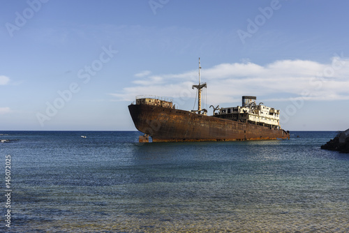 Foto op Plexiglas Schipbreuk Rusted ship in industrial area on Lanzarote, Canary Islands, Spain