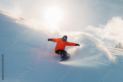 Poster Glisse hiver snowboarder is riding from snow hill