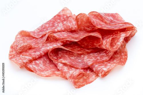 Valokuvatapetti Salami smoked sausage slices isolated on white background cutout.
