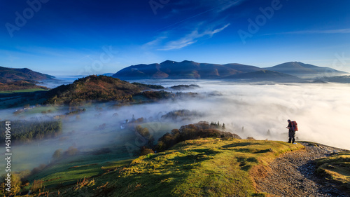 Fotografie, Obraz Fell walker ascending Catbells, The Lake District, Cumbria, England