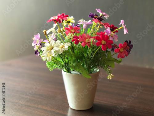 Papiers peints Narcisse Colorful flower pot decorated on wooden table