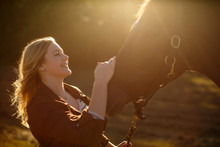 Young Woman Standing Stroking Horse, Smiling