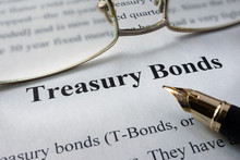 Page Of Newspaper With Words Treasury Bonds. Trading Concept.