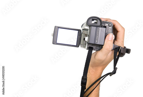 Male hand holding a camcorder camera with a cutout for photo isolated on white Tablou Canvas