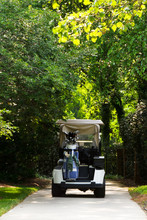 Golf Cart On Cement Path