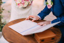 Newlyweds Put Their Signatures...