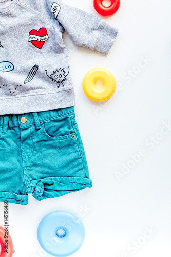 dded7caf3afd Baby clothes and toys on white background top view mock up - Buy ...