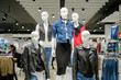 Set of woman mannequins in modern leather and jeans jackets, vest in clothes store