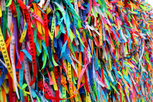 Colorful Ribbons In Front Of A Catholic Church Called Senhor Do Bonfim In Salvador, Bahia In Brazil. Famous Touristic Place Where People Make Wishes While Tie The Ribbons In The Carnival Land.