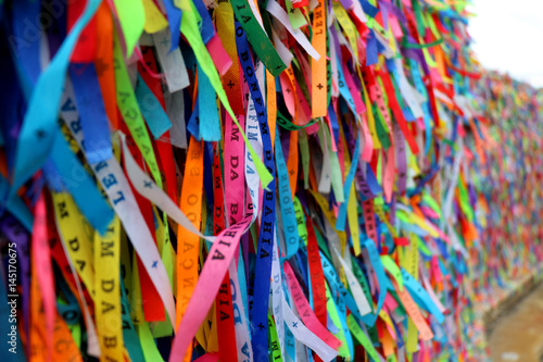 Deurstickers Paradijsvogel Colorful ribbons in front of a catholic church called Senhor do Bonfim in Salvador, Bahia in Brazil. Famous touristic place where people make wishes while tie the ribbons in the Carnival land.