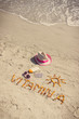 Medical pills, inscription vitamin A and accessories for sunbathing on sand at beach, healthy, beautiful and lasting tan