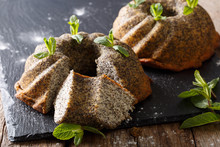 Freshly Delicious Pound Poppy Cakes With Mint Close Up. Horizontal