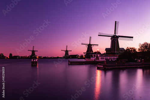 Photo  Traditional Dutch windmills in Zaanse Schans in sunrise time, Amsterdam area, Ho