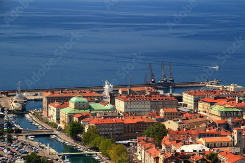 Sunny cityscape of Rijeka, the largest port of Croatia, with colorful rooftops of city center,  Rjecina river and the blue water of Kvarner Gulf, Adriatic Sea, from Trsat