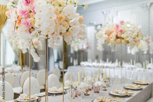 Steel Vases With Orchids Stand On Dinner Table Buy This Stock