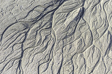 Beach Patterns Caused By The Retreating Tide.