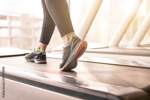 Wallpaper Mural Woman running in a gym on a treadmill concept for exercising, fitness and health