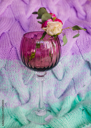 Garden Poster Look from above at a glass with beige and pink roses