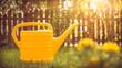 canvas print picture - Gelbe Gießkanne im Garten