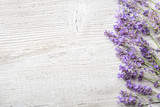 Sprigs of lavender on  wooden background