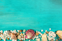Shells And Pebbles On Turquoise Background With Copyspace