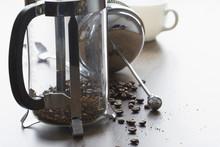 Coarse Ground Coffee Bean In Clear French Press Mug