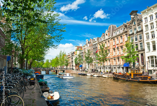 Amsterdam canals and typical houses with clear summer sky Canvas Print