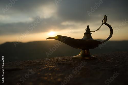 Fotografie, Obraz  Antique artisanal Aladdin Arabian nights genie style oil lamp with soft light white smoke