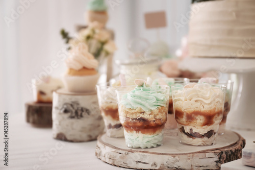 Poster Wooden stand with tasty dessert on table