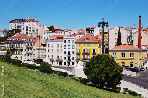 Lisbon architecture. Colorful houses against the blue sky Canvas Print