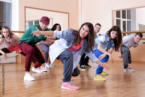 plakat Group of young hip-hop dancers in studio