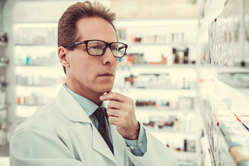 Handsome pharmacist working