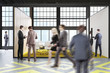 Conference room, yellow and gray floor, people