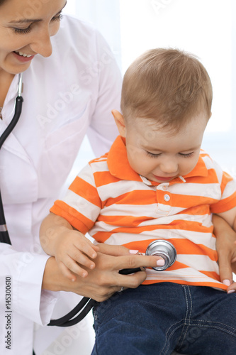 Boy is examine by female doctor for the