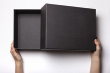Woman Hand Hold A Black Box Isolated White.