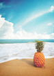 Ripe pineapples on the sandy tropical beach with clear blue sky. Leisure in summer and Summer vacation concept. vintage color tone.