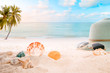 Summer accessories on sandy in seaside summer beach with starfish, shells, coral on sandbar and blur sea background. Concept of recreation in summertime on tropical beach. vintage color tone styles.