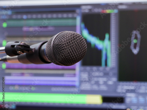 Photo  Microphone on the background of the computer monitor