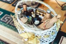 Wine Bottles In A Basket On A Floor