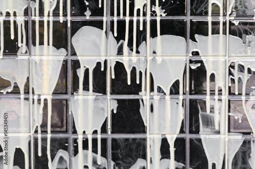 Spoed Foto op Canvas Muziekwinkel glue coat on wall tile black background