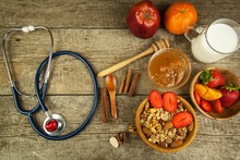 Stethoscope And Oatmeal With Strawberries. The Concept Of Healthy Eating. Diet Food.