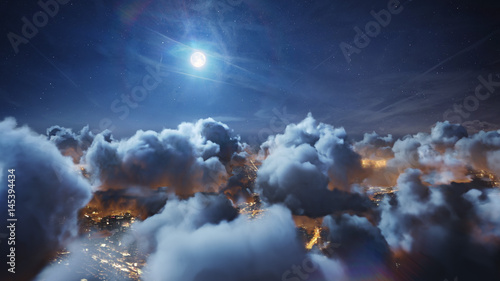 Flying over the deep night timelapse clouds with moon light. Seamlessly looped animation. Flight through moving cloudscape over night city lights. Perfect for cinema, background, digital composition. - 145394434