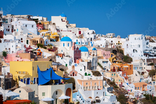 Papiers peints Santorini Traditional white architecture with blue churches on Santorini island, Greece