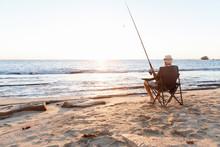 Senior Man Fishing At Sea Side