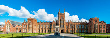 The Queen's University Of Belfast With A Grass Lawn In Sunset Light. Wide Panorama,
