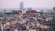 Barcelona rooftops and distant seaport, Spain. 4K long focus pan shot