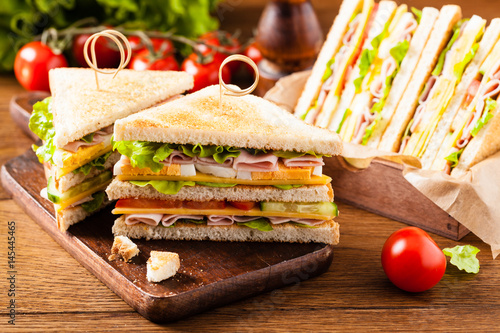 Poster Snack Delicious toast sandwich with ham, cheese, egg and vegetables.