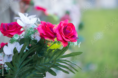 Spoed Foto op Canvas Begraafplaats Flowers in a cemetery